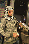 Israel, Negev,a young Bedouin pours traditional coffee