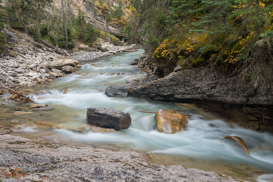 Fast running water downstream from the Lower Falls at Johnston Canyon, Banff National Park, Alberta, Canada.