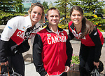 Calgary, AB - June 5 2014 - Karl Ludwig poses for a photo with Women's National Hockey Team members Marie-Philip Poulin and Rebecca Johnston during the Celebration of Excellence Heroes Tour visit to Ronald McDonald House in Calgary. (Photo: Matthew Murnaghan/Canadian Paralympic Committee)