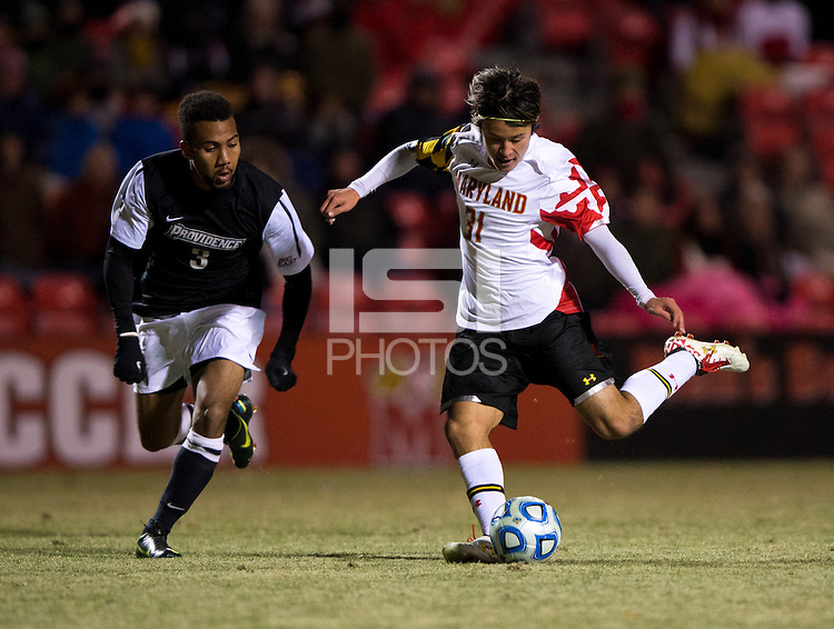 Tsubasa Endoh (31) of Maryland takes a shot in front of George Hodge (3) of Providence during the second round of the NCAA tournament at Ludwig Field in College Park, MD.  Maryland defeated Providence, 3-1.