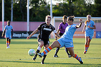 Becky Edwards (14) of the Western New York Flash and Carolyn Blank (31) of Sky Blue FC go for the ball. The Western New York Flash defeated Sky Blue FC 4-1 during a Women's Professional Soccer (WPS) match at Yurcak Field in Piscataway, NJ, on July 30, 2011.