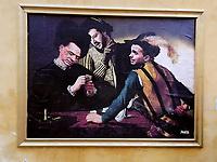 Roma 13/04/2018. Un murale è apparso stamattina vicino al Quirinale, firmato Sirante, riprende un famoso quadro del Caravaggio, 'i bari' sostituendovi le facce di Berlusconi Salvini e Di Maio. Il Murale è stato rimosso in brevissimo tempo.<br /> Rome April 13th 2018.Early this morning, while the second day of consultation was about to start, a painting appeared next to the Quirinale, showing a famous Caravaggio's painting, The Cardsharps, with the faces of Silvio Berlusconi, Matteo Salvini and Luigi Di Maio. The painting was soon removed by police.<br /> Foto Insidefoto