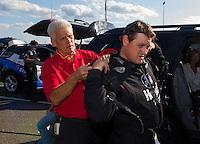 May 30, 2014; Englishtown, NJ, USA; Jim Head (left) helps his son NHRA funny car driver Chad Head during qualifying for the Summernationals at Raceway Park. Mandatory Credit: Mark J. Rebilas-