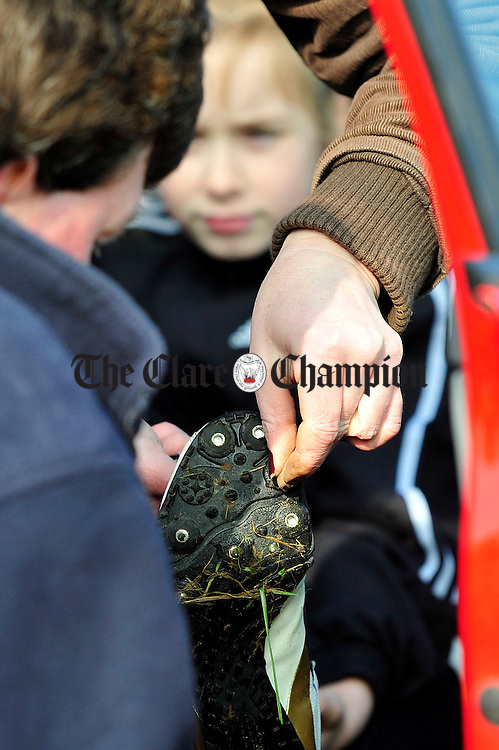10 year old Niamh Fitzhenry has her studs removed before competing in the cross country at Kilnaboy.pic Arthur Ellis.