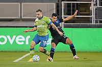 SAN JOSE, CA - OCTOBER 18: Jordan Morris #13 of the Seattle Sounders battles for the ball with Andy Rios #25 of the San Jose Earthquakes during a game between Seattle Sounders FC and San Jose Earthquakes at Earthquakes Stadium on October 18, 2020 in San Jose, California.