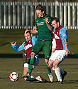 Stirling's Lewis Bonar is challenged by Whitehill's Gareth Thom and Ryan McKenzie.