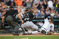Chicago White Sox catcher Kevan Smith (36) waits for the throw as Nick Castellanos (9) of the Detroit Tigers slides across home plate while umpire Mark Carlson looks on at Comerica Park on June 2, 2017 in Detroit, Michigan.  The Tigers defeated the White Sox 15-5.  (Brian Westerholt/Four Seam Images)