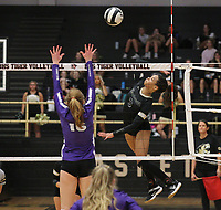 Trinity Hamilton (3) of Bentonville spikes the ball against  Madeline Lafata (16)  of Fayetteville  Thursday, Oct.  7, 2021, during play at Tiger Arena in Bentonville. Visit nwaonline.com/211008Daily/ for today's photo gallery.<br /> (Special to the NWA Democrat-Gazette/David Beach)