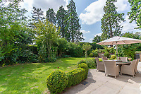 BNPS.co.uk (01202 558833)<br /> Pic: Mullucks/BNPS<br /> <br /> Pictured: The private south facing garden with a terrace and decked seating area. <br /> <br /> Time for a change...<br /> <br /> A former granary with an impressive clock tower on top is on the market for £1.45m.<br /> <br /> The new owners of the aptly-named The Clockhouse will have a tall order adjusting this timepiece when the clocks go back at the end of October.<br /> <br /> The Grade II listed property has a 10ft central wooden clock tower which is believed to date back to the construction of the original granary building in the Georgian era.
