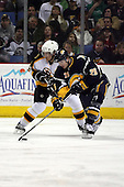 February 17th 2007:  Thomas Vanek (26) of the Buffalo Sabres gets the puck in front of Andrew Ference (21) of the Boston Bruins at HSBC Arena in Buffalo, NY.  The Bruins defeated the Sabres 4-3 in a shootout.