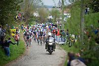 peloton coming through the Oude Kwaremont<br /> <br /> Ronde van Vlaanderen 2014