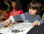 Aidan Abrams-Schwartz,5, gets crafty at the Houston Symphony League's annual Magical Musical Morning event at the Houstonian Saturday Dec. 12,2009.(Dave Rossman/For the Chronicle)