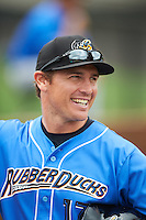 Akron RubberDucks manager Dave Wallace (17) during warmups before the first game of a doubleheader against the Bowie Baysox on June 5, 2016 at Prince George's Stadium in Bowie, Maryland.  Bowie defeated Akron 6-0.  (Mike Janes/Four Seam Images)