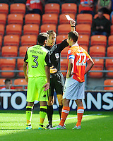 Blackpool's Danny Pugh is shown a yellow card by Referee John Brooks<br /> <br /> Photographer Kevin Barnes/CameraSport<br /> <br /> Football - The EFL Sky Bet League Two - Blackpool v Exeter City - Saturday 6th August 2016 - Bloomfield Road - Blackpool<br /> <br /> World Copyright © 2016 CameraSport. All rights reserved. 43 Linden Ave. Countesthorpe. Leicester. England. LE8 5PG - Tel: +44 (0) 116 277 4147 - admin@camerasport.com - www.camerasport.com