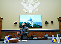 Director of the National Institute for Allergy and Infectious Diseases Dr. Anthony Fauci brings a Washington Nationals face mask when he arrives to testify before the House Committee on Energy and Commerce on the Trump Administration's Response to the COVID-19 Pandemic, on Capitol Hill in Washington, DC on Tuesday, June 23, 2020.    <br /> Credit: Kevin Dietsch / Pool via CNP/AdMedia