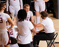 STANFORD, CA - FEBRUARY 19: Tara VanDerveer head coach of the Stanford Cardinal talks with the team at a timeout during a game between Arizona State University and Stanford University at Maples Pavilion on February 19, 2021 in Stanford, California.