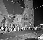 Pittsburgh PA: View of Christmas Services outside the First Luthern Church on Grant Street in Pittsburgh.  Image of Pastor leading the church choir and faithful in song and prayer.  Many of the group were dressed in period clothing at the time of Jesus's birth.  Brady Stewart Jr took the photography using a large spotlight.
