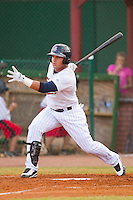 Oswaldo Arcia #24 of the Elizabethton Twins follows through on his swing against the Greeneville Astros at Joe O'Brien Field August 15, 2010, in Elizabethton, Tennessee.  Photo by Brian Westerholt / Four Seam Images