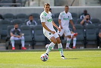 LOS ANGELES, CA - APRIL 17: Matt Besler #5 of Austin FC turns with the ball during a game between Austin FC and Los Angeles FC at Banc of California Stadium on April 17, 2021 in Los Angeles, California.