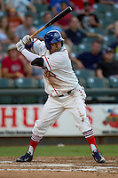 Wearing an Austin Senators throwback uniform, Round Rock Express designated hitter Manny Ramirez (39) at bat during the Pacific Coast League baseball game against the Oklahoma City RedHawks on July 9, 2013 at the Dell Diamond in Round Rock, Texas. Round Rock defeated Oklahoma City 11-8. (Andrew Woolley/Four Seam Images)