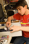 11 year old boy organizing his baseball card collection