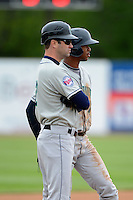 Cedar Rapids Kernels outfielder Byron Buxton #7 stands on third with manager Jake Mauer during a game against the Beloit Snappers on May 23, 2013 at Pohlman Field in Beloit, Wisconsin.  Beloit defeated Cedar Rapids 5-3.  (Mike Janes/Four Seam Images)