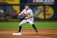 Northwest Arkansas Naturals third baseman Hunter Dozier (24) touches third for a force out while looking to first during a game against the Springfield Cardinals on April 26, 2016 at Hammons Field in Springfield, Missouri.  Northwest Arkansas defeated Springfield 5-2.  (Mike Janes/Four Seam Images)