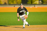 Wake Forest Demon Deacons second baseman Conor Keniry (14) on defense against the West Virginia Mountaineers at Wake Forest Baseball Park on February 24, 2013 in Winston-Salem, North Carolina.  The Demon Deacons defeated the Mountaineers 11-3.  (Brian Westerholt/Four Seam Images)