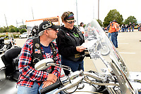 DEAL ME IN<br />Bob Hand and his wife, Patti Hand, of Springdale, check the route Saturday Sept. 12 2020 before heading down the highway in the 14th annual Summer Fun Run Ride For Life motorcycle poker run. The ride is a fundraiser for Circle of Life Hospice, said Dee Vaughn with Circle of Life. An all-volunteer board and staff puts on the ride. Bikers covered a 119-mile route through Benton, Washington and Madison counties with five poker-chip draw stations along the way. Go to nwaonline.com/200913Daily/ to see more photos.<br />(NWA Democrat-Gazette/Flip Putthoff)