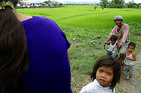 Dominador Maning and family wait for the passage of the convoy bearing presidential candidate Fernando Poe Jr. through San  Rafael, Bulacan. 11 February 2004