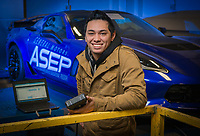 Automotive Technology student Justin Gentz, who is enrolled in the General Motors (GM) Automotive Service Educational Program (ASEP), photographed with a 2016 Chevrolet Corvette Z06, which GM donated to the program. Gentz recently had the opportunity to work on the Covette's Brembo carbon ceramic brakes.