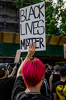 NEW YORK, NEW YORK - JUNE 03: A protester holds a sign during a protest against the death of George Floyd on June 3, 2020 in Brooklyn, New York. Protests spread across the country in at least 30 cities across the United States, over the death of unarmed black man George Floyd at the hands of a police officer, this is the latest death in a series of police deaths of black Americans. (Photo by Pablo Monsalve / VIEWpress via Getty Images)