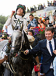 ELMONT, NY - JUNE 11: Irad Ortiz Jr., aboard Creator #13, celebrates after winning the Belmont Stakes as owner Bobby Flay (R) leads him into the winner's circle on Belmont Stakes Day on June 11, 2016 in Elmont, New York. (Photo by Sue Kawczynsk/Eclipse Sportswire/Getty Images)