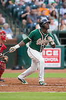 K.J. Woods (32) of the Greensboro Grasshoppers follows through on his swing against the Greenville Drive at NewBridge Bank Park on August 17, 2015 in Greensboro, North Carolina.  The Drive defeated the Grasshoppers 5-4 in 13 innings.  (Brian Westerholt/Four Seam Images)