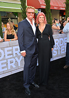 """LOS ANGELES, USA. June 11, 2019: Jake Busey & April Hutchonson at the premiere of """"Murder Mystery"""" at Regency Village Theatre, Westwood.<br /> Picture: Paul Smith/Featureflash"""