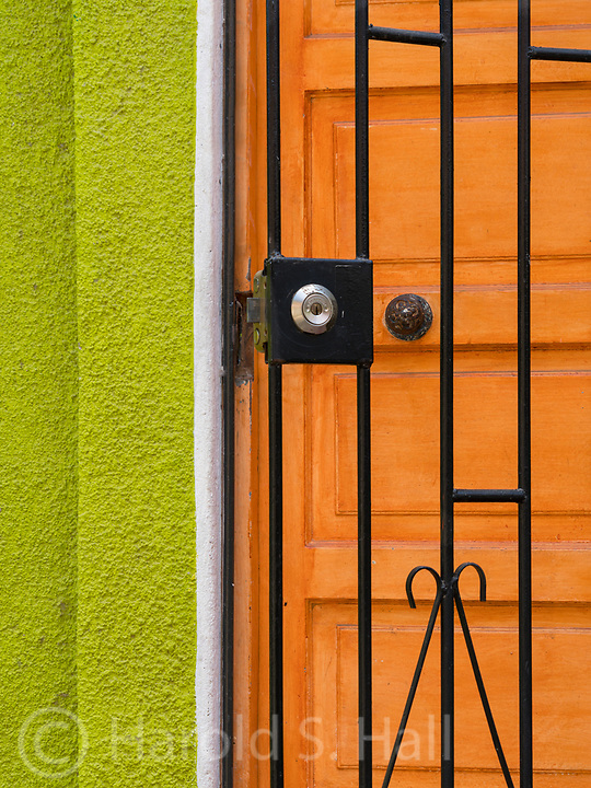 Among the many colorful walls of brightly colored graffiti in Valpariso, Chile was this house  freshly painted in lime green and a necessary protective iron gate.