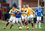 07.04.2019 Motherwell v Rangers: Scott Arfield with Alex Rodriguez-Gorrin and Tom Aldred