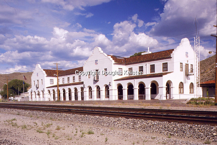 In 1923, the Union Pacific Railroad hired the prominent Los Angeles architects John and Donald Parkinson to design this imposing station at Caliente, Nevada, to replace one that had burned two years earlier.  The result was this surprisingly late Mission Revival structure whose arcades and espadañas hark back to station designs of a decade earlier.  However conservative its design, the station's construction budget of $83,600 was unstinting, providing for a lavish oak-trimmed interior, along with a restaurant and fifty-room hotel to boot.  The building now houses Caliente's civic center.