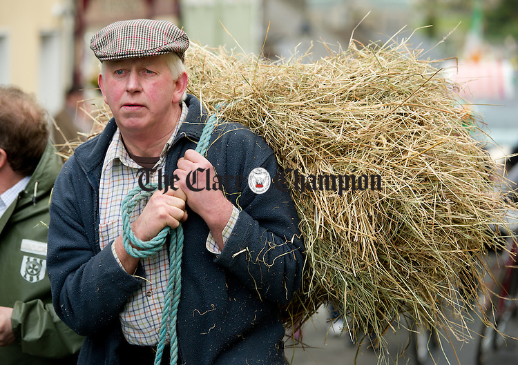Patrick Floyd adding an agricultural theme to the St Patrick's Day Parade at Killaloe. Photograph by John Kelly.