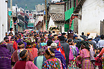 A procession of Guatemalan Indians in traditional dress walk through the streets towards the cememtary in Zunil, Guatemala, in the Western Highlands