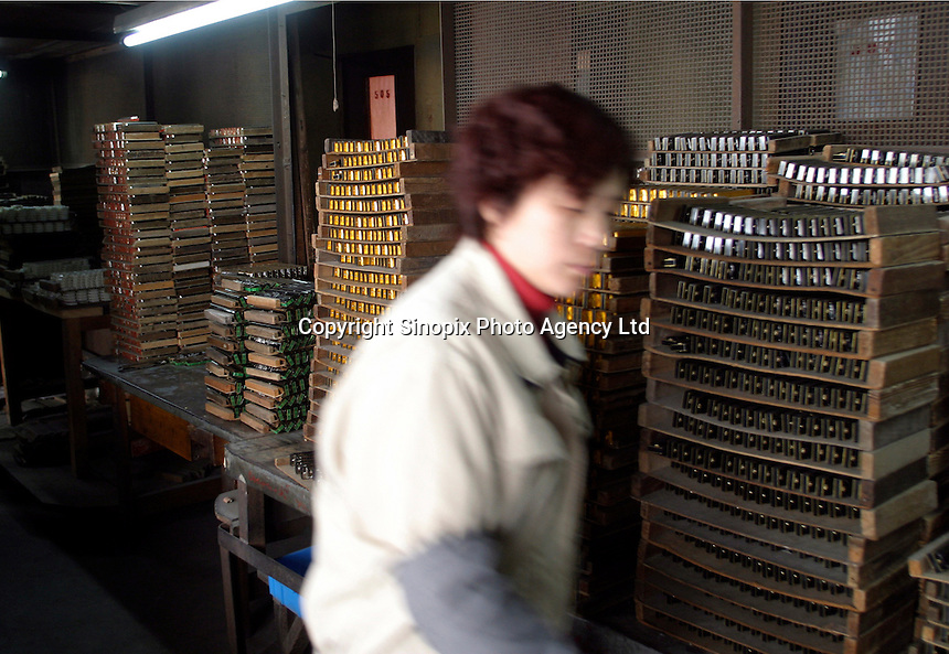 A clerk in the store room of the Shanghai General Harmonica Factory (SGHF) in Shanghai, China. Although it makes well-respected brands such as the Huang, Suzuki, and Hohner that are favored by many professional musicians around the world, the 60 years old state owned SGHF had to trim down its work force from 800 in the mid 1980's to just over 100 today..23-FEB-04