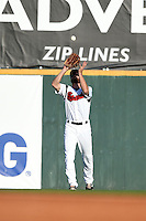 Nashville Sounds outfielder Kevin Mattison (2) catches a fly ball during the first game of a double header against the Omaha Storm Chasers on May 21, 2014 at Herschel Greer Stadium in Nashville, Tennessee.  Nashville defeated Omaha 5-4.  (Mike Janes/Four Seam Images)