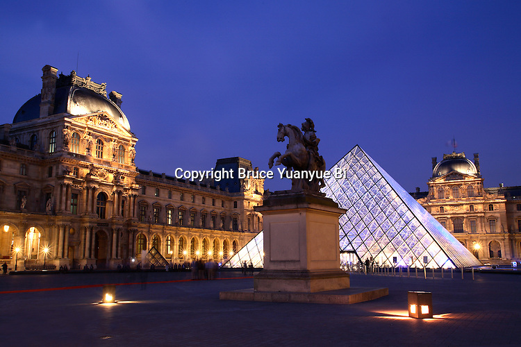 The night view of Cour Napoleon (Napoleon Courtyard) in Musee du Louvre(Museum Louvre) with the glass pyramid in the background. Paris. France