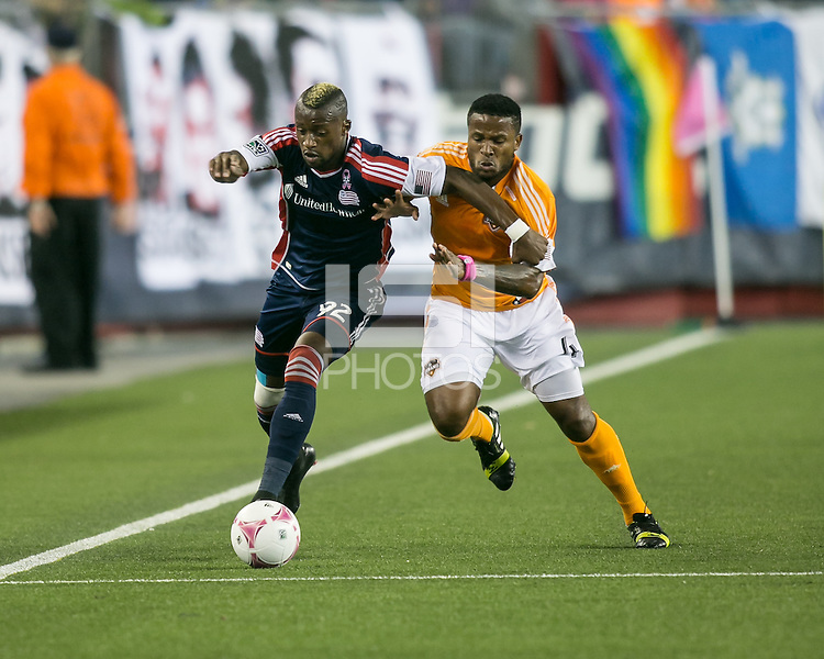 New England Revolution forward Dimitry Imbongo Boele (92) advances down the side as Houston Dynamo defender Jermaine Taylor (4) moves in to tackle.  The New England Revolution played to a 1-1 draw against the Houston Dynamo during a Major League Soccer (MLS) match at Gillette Stadium in Foxborough, MA on September 28, 2013.