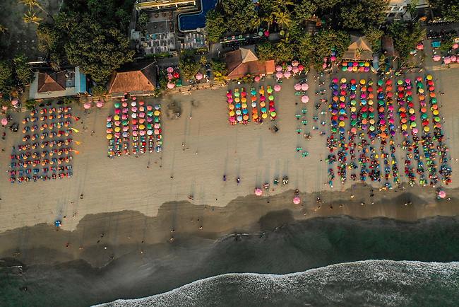 6 DECEMBER, 2019 BALI, INDONESIA: Crowd line the shore on at sunset on Masari Beach,Seminyak in Bali. There has been a levelling out of Australian tourist numbers to Bali in recent times and tastes are changing regarding what people want from their holiday. Picture by Graham Crouch/The Australian