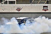 Monster Energy NASCAR Cup Series<br /> Go Bowling 400<br /> Kansas Speedway, Kansas City, KS USA<br /> Saturday 13 May 2017<br /> Martin Truex Jr, Furniture Row Racing, Auto-Owners Insurance Toyota Camry celebrates his win with a burnout<br /> World Copyright: Nigel Kinrade<br /> LAT Images<br /> ref: Digital Image 17KAN1nk10390