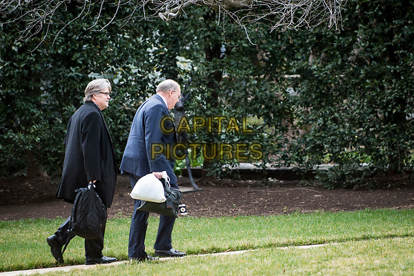 Chief strategist to President Trump, Stephen Bannon and Deputy Chief of Staff for Operations, Joe Hagin, walk to the West Wing after returning to the White House aboard Marine One with President Donald Trump on the South Lawn of the White House in Washington, District of Columbia, U.S., on Sunday, March 19, 2017. President Trump is returning from a weekend at his Mar-a-Lago resort in Palm Beach, Fla. <br /> CAP/MPI/CNP/RS<br /> ©RS/CNP/MPI/Capital Pictures