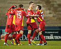 Pars' Stephen Husband celebrates with Craig Dargo  after he scores Dunfermline's third  ...