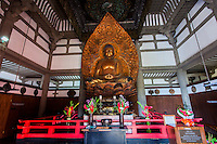 The Amida Buddha statue surrounded by a diversity of religious symbols inside the Byodo-In Temple at the Valley of the Temples Memorial Park, Kane'ohe, O'ahu.