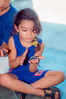 children examine hatchlings of Kemp's ridley sea turtle, Lepidochelys kempii, during educational program at turtle research camp, Rancho Nuevo, Mexico, Gulf of Mexico, Atlantic Ocean